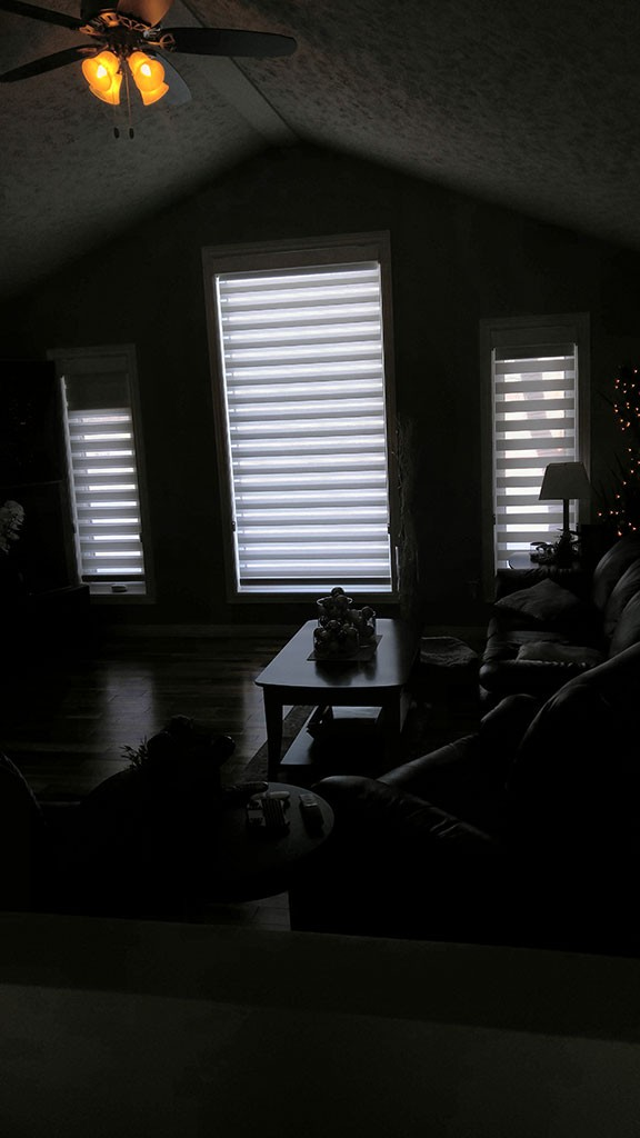 soft white shades almost completely blocking the daylight from 3 living room windows