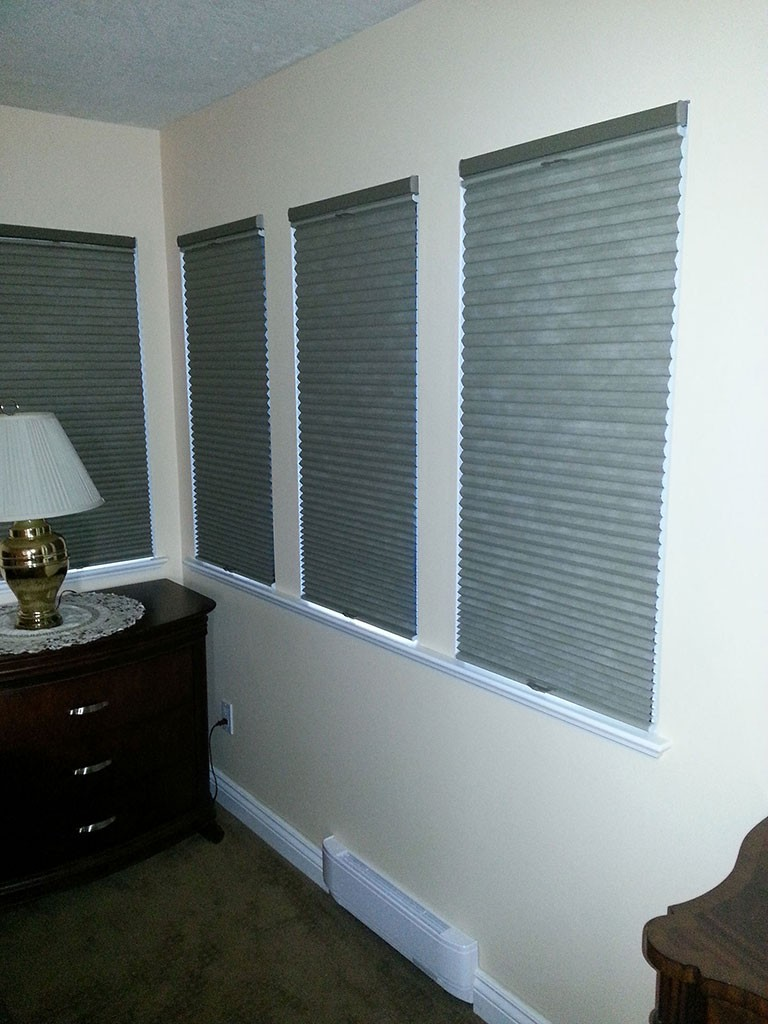 soft grey shades fully blocking the light out of 4 bedroom windows