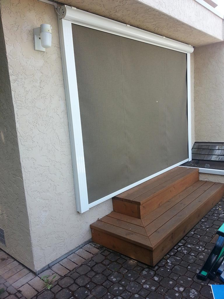 closed exterior drop awning on a patio door