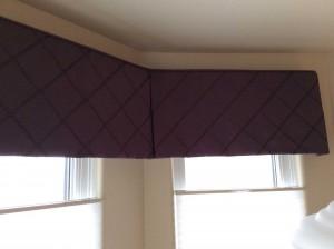 purple drapery toppers on windows